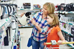 Mother and daughter shopping for electric kettle Stock Photography