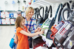 Mother and daughter shopping for electric vacuum cleaner Royalty Free Stock Photography