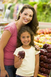 Mother and daughter shopping for fresh produce. In supermarket Royalty Free Stock Photo