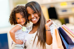 Mother and daughter shopping Stock Photos