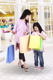 Mother and daughter shopping at mall Royalty Free Stock Images