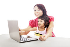 Mother and Daughter Shopping Online Stock Images