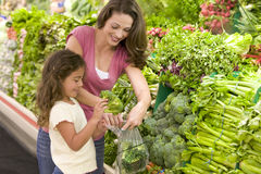 Mother and daughter shopping for produce Stock Image