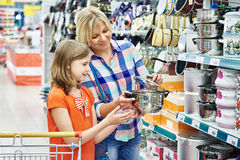 Mother and daughter shopping saucepan for kitchen Stock Image