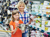Mother and daughter shopping saucepan for kitchen Stock Photo