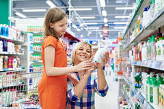 Mother and daughter shopping shampoo Stock Image