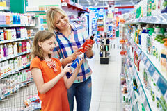 Mother and daughter shopping shampoo Royalty Free Stock Image