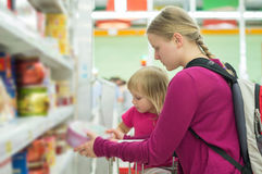 Mother and daughter shopping in supermarket Royalty Free Stock Photo