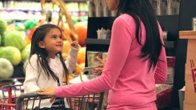 Mother And Daughter Shopping In Supermarket. Daughter demands candy in supermarket - mother refuses and walk past display. Shot on Canon 5d Mk2 with a frame rate stock video