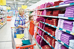 Mother and daughter shopping towels Stock Photo