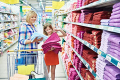 Mother and daughter shopping towels Stock Images