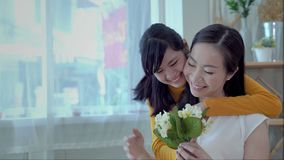 Mother and daughter are showing love each other. South East Asian families