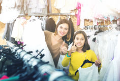 Mother and daughter showing their purchases Royalty Free Stock Image