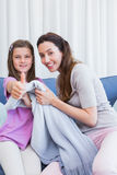 Mother and daughter showing thumbs up Stock Photography