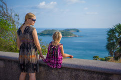 Mother and daughter at side of tropical island view piont Stock Photography