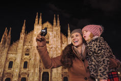 Mother and daughter sightseeing and taking photos in Milan Stock Photo