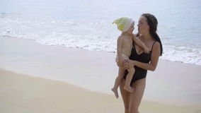 Mother and daughter are singing on the beach stock video