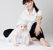 Mother and daughter sits on the floor Stock Images