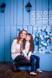 Mother and daughter sitting in a beautiful interior royalty free stock image