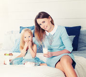 Mother and Daughter Sitting on the Bed Royalty Free Stock Photography
