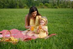 Mother and daughter sitting on blanket Royalty Free Stock Photography