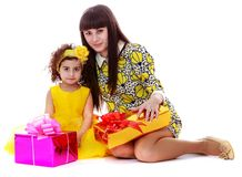 Mother and daughter sitting on the floor Stock Photos