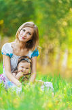 Mother daughter sitting grass Royalty Free Stock Photos