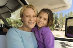 Mother and daughter sitting in RV royalty free stock images