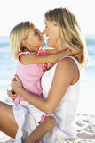Mother And Daughter Sitting Together On Beach Royalty Free Stock Photo