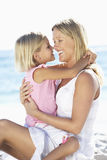 Mother And Daughter Sitting Together On Beach Royalty Free Stock Photography