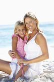 Mother And Daughter Sitting Together On Beach Royalty Free Stock Images