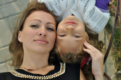 Mother and daughter. Sitting together on a bench Stock Photo