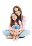 Mother and daughter sitting Stock Photography