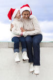 Mother and daughter in skates Stock Photos