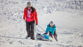 Mother And Daughter Sled Ride III Stock Photos
