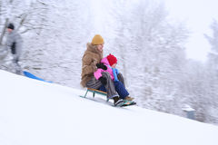 Mother and daughter sledging Royalty Free Stock Image
