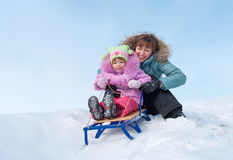 Mother and daughter sledging Royalty Free Stock Photo