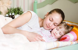 Mother and daughter sleep Stock Photography