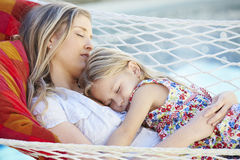 Mother And Daughter Sleeping In Garden Hammock Together Royalty Free Stock Images