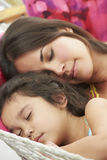 Mother And Daughter Sleeping In Garden Hammock Together Royalty Free Stock Image