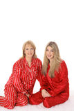 Mother and daughter sleepover in pajamas. Isolated on white Royalty Free Stock Photo