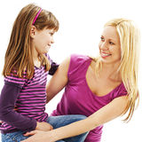Mother and daughter smile at each other lovingly Stock Images