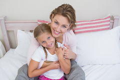 Mother and daughter smiling at camera Stock Images