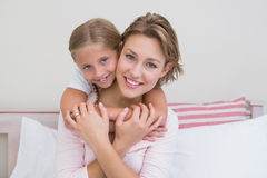 Mother and daughter smiling at camera Royalty Free Stock Photography