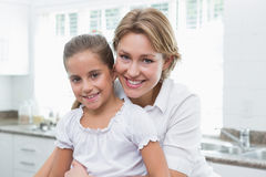 Mother and daughter smiling at camera Royalty Free Stock Photo
