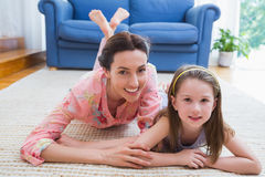 Mother and daughter smiling at camera Royalty Free Stock Image