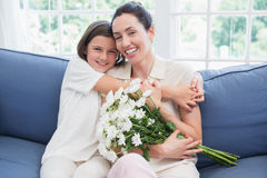 Mother and daughter smiling at camera Royalty Free Stock Photos