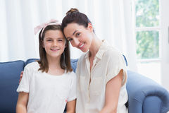Mother and daughter smiling at camera Stock Image