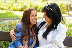 Mother and daughter smiling at each other Royalty Free Stock Photos