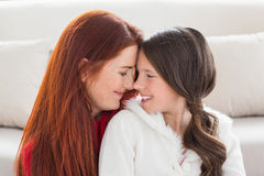Mother and daughter smiling at each other Stock Photos